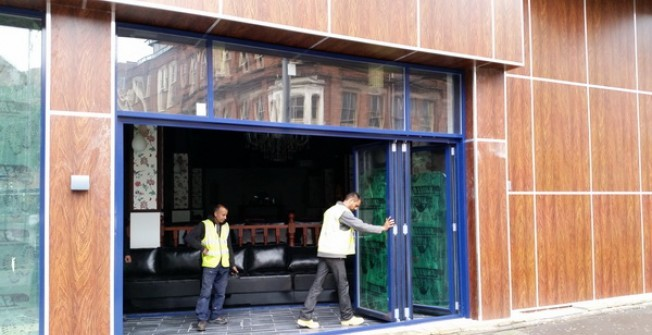 Commercial BiFold Door in Avening Green